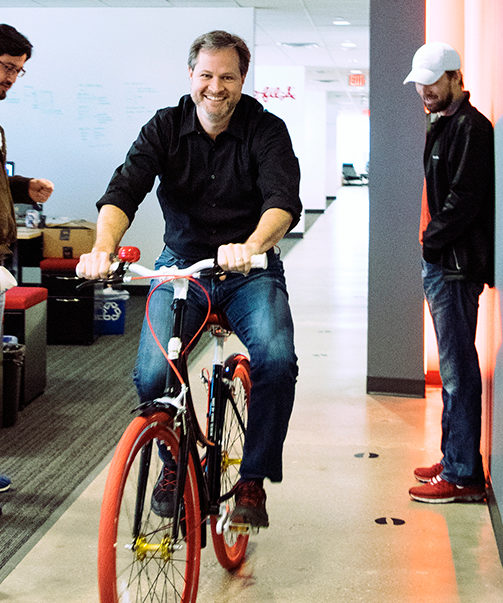 Calvin Carter testing out a new bike in the office. Photo courtesy Bottle Rocket.