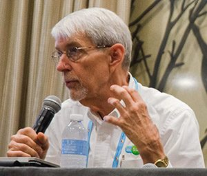 Bob Helle talks about how cities need to evolve at the TIA conference in Dallas, Texas. Photo by Hannah Ridings.