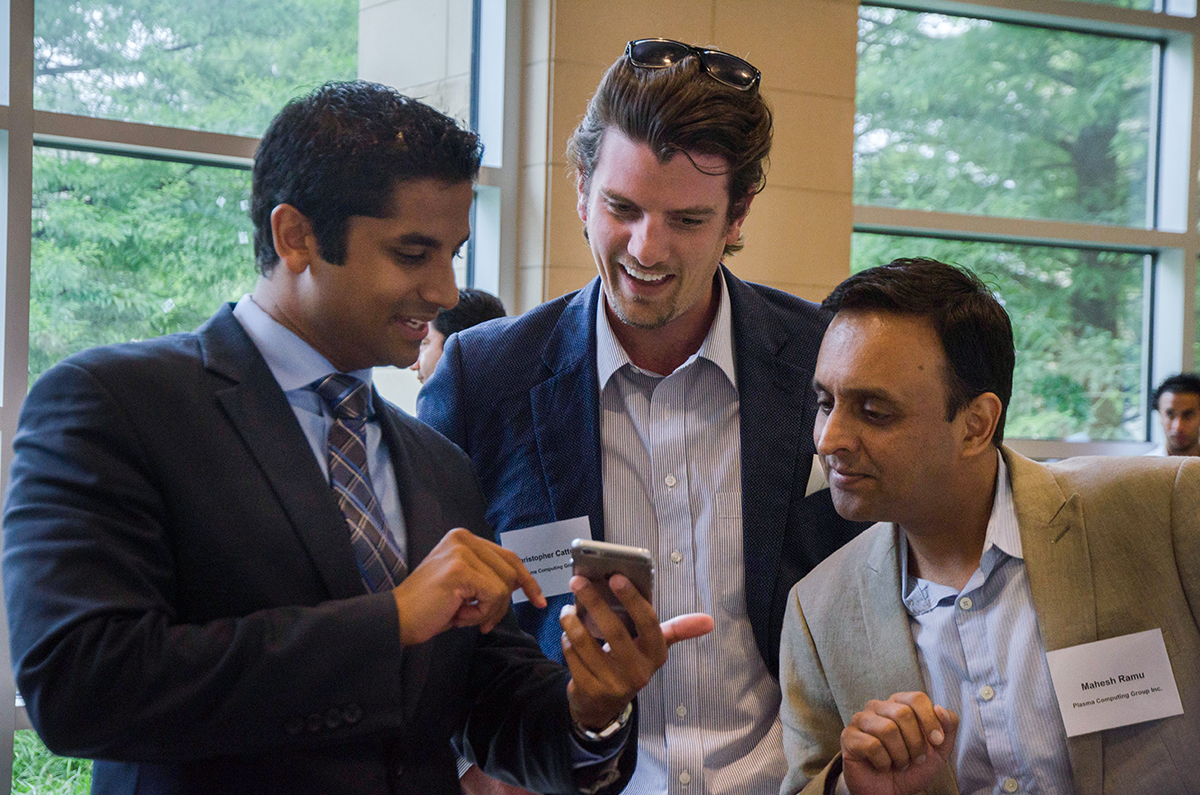 Chris Bhatti networks with fellow businessmen Christopher Cattertton and Mahesh Ramu at the UT Dallas Tech Titans Event. Photo by Hannah Ridings.