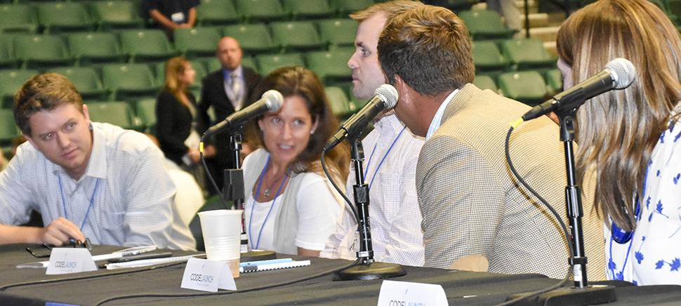 CodeLaunch judges deliberate. [ Photo: Dallas Innovates ]