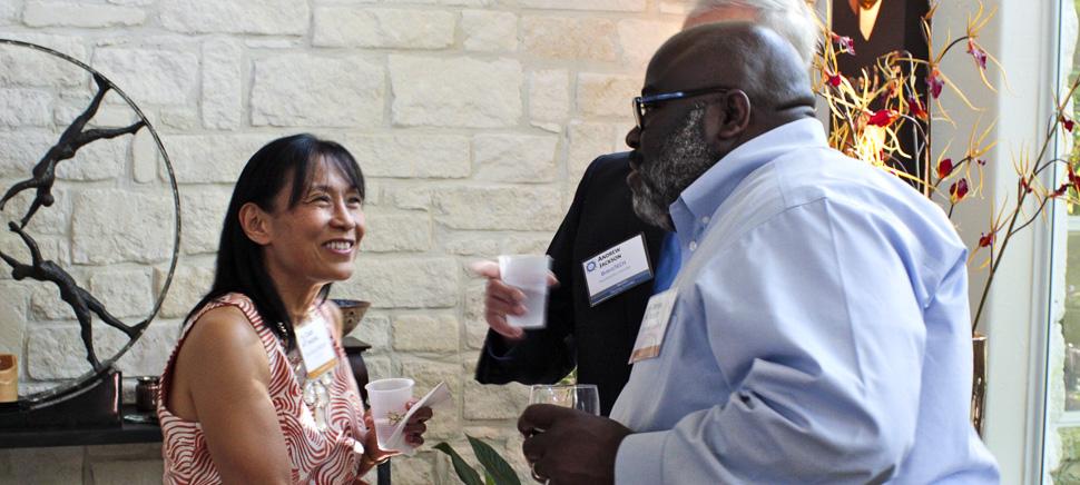 Technology Ball Executive Hosts Caren Shiozaki, EVP & CIO, Thornburg Mortgage and Onyeka Nchege, CIO, Interstate Batteries shaking hands. [Photo via Technology Ball]