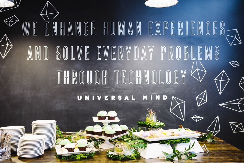 The UM Mission was front and center near the dessert table. [ Photo via Universal Mind ]