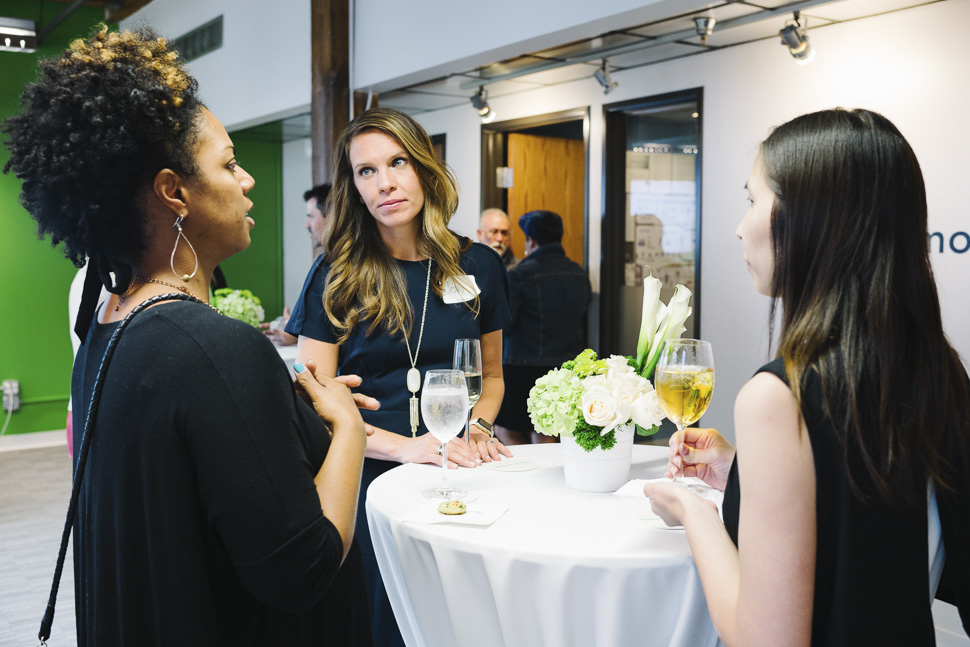 UMs Jesslly Beattie and Megan Tom meeting with guests. [ Photo via Universal Mind ]