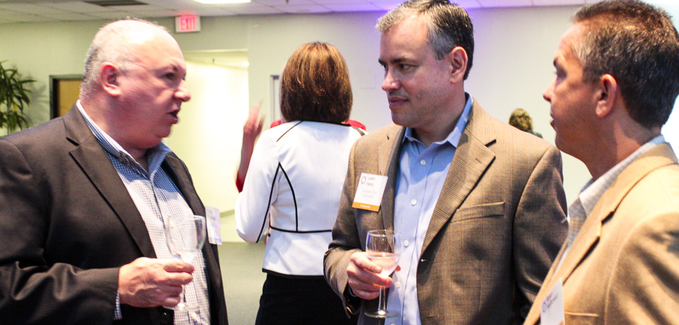 Rost Ginevich of Overdale Group with Executive Hosts Larry Freed, CIO, Overhead Door and Robby McDonald