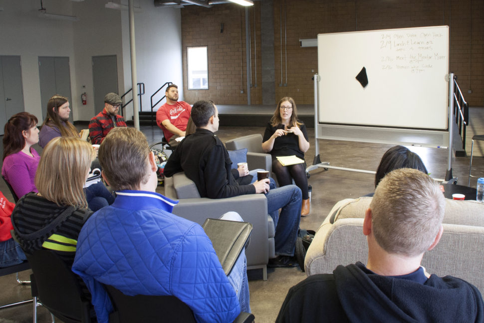 Heather Gregory leads a morning huddle with the coworkers and entrepreneurs that use the space in Stoke to run their business.