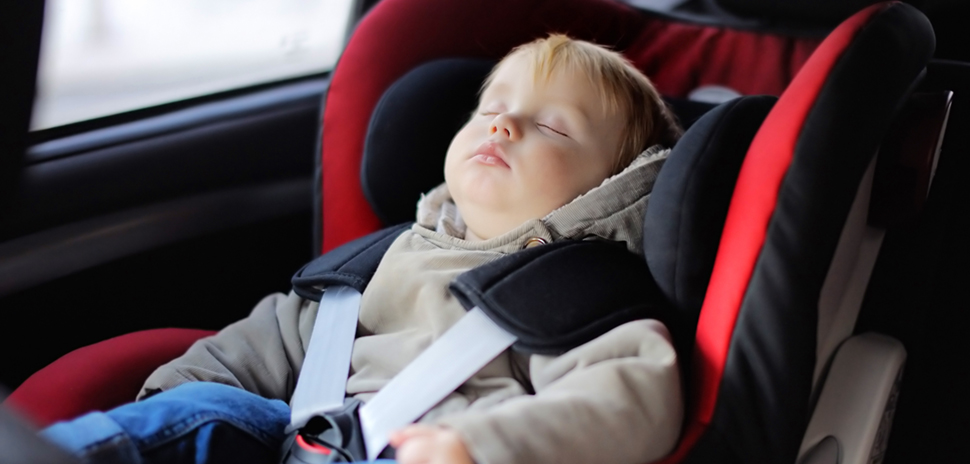 Toddler boy sleeping in car seat