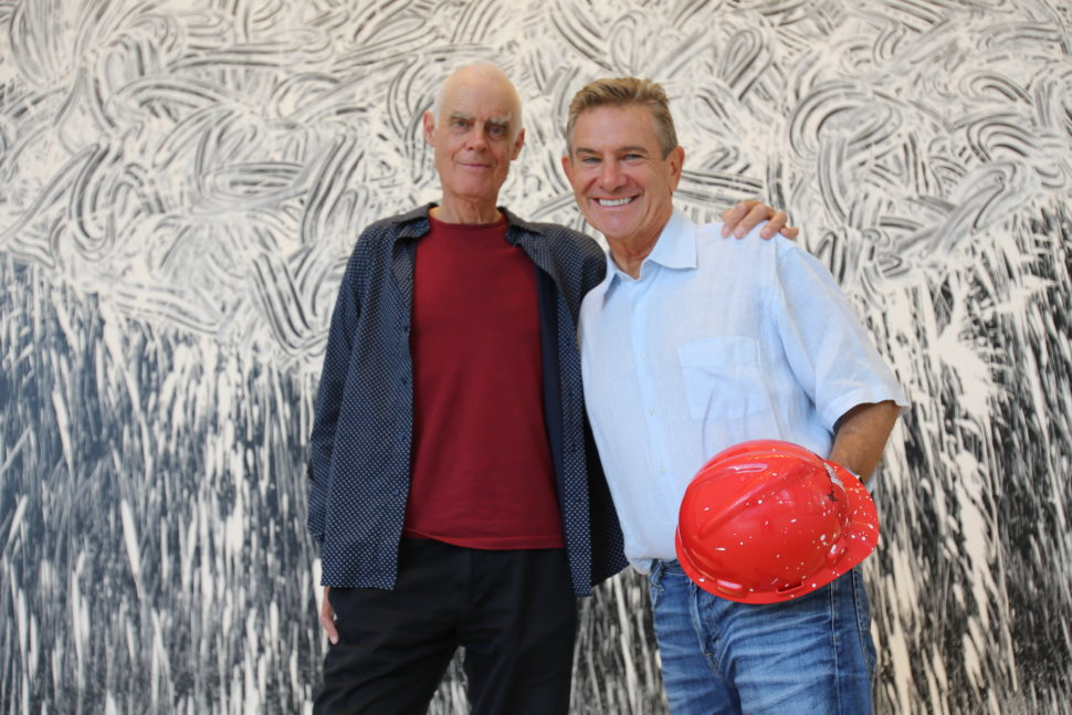 Craig Hall, right, and Richard Long in front of Dallas Rag in the KPMG Plaza lobby.