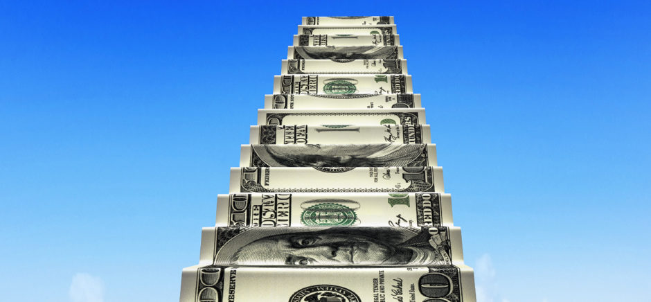 Money stairs with white 2016 arrow up shape clouds in blue sky.